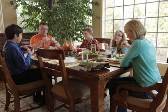 Family sitting at the dinner table having lunch
